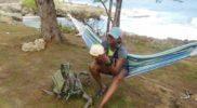drinking-coconut-water-hammock-beach
